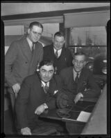 Sheriff Gene Biscailuz tries new radio equipment with Herbert C. Legg, Gordon L. McDonough, and Charles Ellison, Los Angeles, 1936
