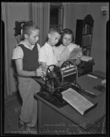 Bruce Kenson, Paul Bullock, and Jacqueline Williamson edit a newspaper for their school, Pasadena, 1936