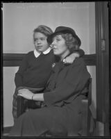 Buron Fitts' wife Marion and daughter Mary Lou wait while Fitts is tried for perjury, Los Angeles, 1936