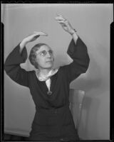Reverend Elsie Peters communicates church services to her deaf congregation through sign language, Los Angeles, 1936