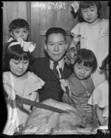 Tabin Kato surrounded by young children, Los Angeles, 1936