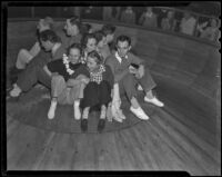 Ann McNaghten and friends on a ride at Venice Beach fun house, Venice (Los Angeles), 1936