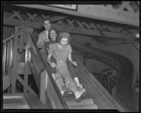 Young adults on a slide at Venice Beach fun house, Los Angeles, 1936