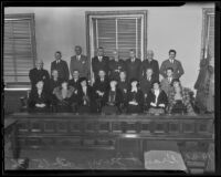 Newly chosen 1936 Grand Jury Mmes. Florence Campbell, Dorothy Hitchcock, Anna May Dunlap, Katherine Mounsey, Pearl Marsh, Catherine E. Breslin, Margaret Kaeding, Superior Judge Thomas L. Ambrose, R. H. Tuttle, Emmett R. Aiken, George B. Warren, C. V. Lane, Dr. Anders Peterson, Harry Beaman, C. E. Fisher, Roy R. Hall, Robert S. Redinton, C. R. Burrows, Frank Holman, James B. Agnew, and Dep. Dist.-Atty. Bialock, Los Angeles, 1936