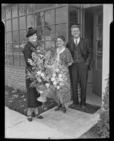 Mrs. Oscar Rosbach, Mrs. F. W. Collins, and Mr. F. W. Collins pose with flowers at the opening of the San Marino Tribune newspaper plant, San Marino, 1936