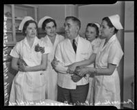 Head Nurse Charles H. Whitehead celebrates 20 years in his position with fellow nurses Francis Hurley, Pauline Payne, Maude Caffey, and Lila Strange, Los Angeles, 1936