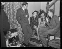 Richard Ritchie, Alma Lloyd, Paula Stone, and Ronald Howard at a cocktail party, Los Angeles, 1936