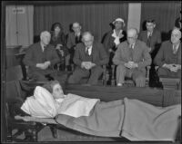 Golda Gose rests on her stretcher in front of the jury, Los Angeles, 1936