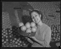 Frances Lee Bussey with a basket of oranges, San Bernardino, 1936