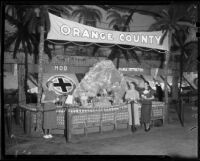 Frances Lee Bussey, Phyllis Cox, and Elinor Brown next to a display of Borabora Island, San Bernardino, 1936