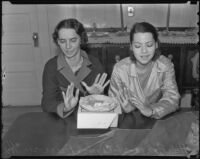 Sisters Atela and Carmen Anaza show disgust over being offered pie after they recovered from food poisoning, Los Angeles, 1936