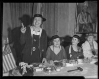Wilma D. Hoyal stands, while Louise Ward Watkins, Edith Van de Water, and an unidentified woman look on, 1936