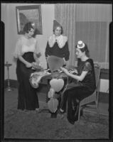 Catholic Women's Club Juniors members wear novelty hats and prepare heart-shaped decorations, 1936