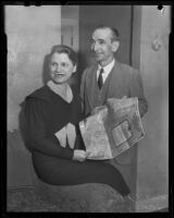 Mr. and Mrs. James Roy Willis show a map of the oil land they inherited, Los Angeles, 1936