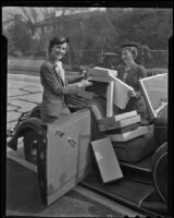 Kate Ridgway and Louise Sterry pile donated items into a car, 1936