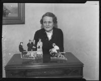 Marion Eastman with her paper doll display, Santa Anita, 1935