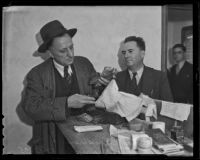 Deputy Sherriff Tom Humphries finds Chas Dalrymple with large sums of cash, Los Angeles, 1935