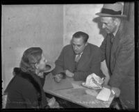 Geneva Farmer questioned by John L. McDonnell and Tod Brown after dollar chain raid, Los Angeles, 1935