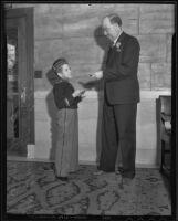 Elmer Spangler, Biltmore Hotel page, and William Jones, Biltmore Hotel guest, Los Angeles, 1935