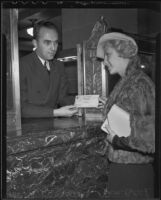 Eva Bostch collecting Bank of America Christmas Club check, Los Angeles, 1935