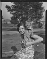 Mrs. S. F. Olson and her tamed pet lynx Gigi, Los Angeles, 1935