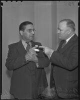 Judge William R. McKay and Bailiff Paul L. Brunette with his injured finger, Los Angeles, 1935