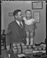 Judge Samuel R. Blake and the recently adopted 17-month-old David Robert Anderson, Los Angeles, 1935