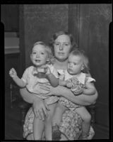 Shirley Marie Johnson and Donna Lee Johnson sit on their mother's lap, upset over the loss of their father, Los Angeles, 1935