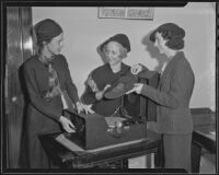 Gertrude Eaton, Mrs. Judex Walker, and Helen Bruck of the Ebell Juniors take on a project to help the blind, Highland Park, 1935