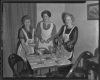Cecile Appleton, Edna Cobb, and Exa Link prepare for the Ebell Club Christmas party, Los Angeles, 1935