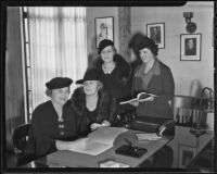 Mrs. Ralph C. Long, Mrs. James Broderick, Mildred Jenal, and Clara Weigel prepare for a fund raising event hosted by the Loyola University Guild, 1935