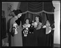 Margaret Lowry and her daughters, Marilyn, Joan, and Patricia, perform a puppet show, Los Angeles, 1935