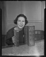 Miss Bernice McCarty compares the 1887 Los Angeles City Directory with the new and improved 1936 Los Angeles City Directory, Los Angeles, 1936
