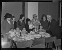 Dr. John L. C. Griffin gives babies a health test for movie auditions, Los Angeles, 1935
