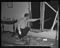 Lyndon Foster inspects the damage done to his apartment, Los Angeles, 1935