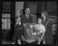 Supervisor Gordon L. McDonough with his children Jimmy and Lucille McDonough and Mrs. Ella Achley, Los Angeles, 1935