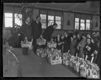 Samuel E. Gates, Rowe Sanderson and Col. Arthur D. Jackson help the needy, Los Angeles, 1935