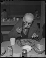 Donald W. McLean eats a Christmas dinner at the Midnight Mission, 1935