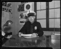 Police Chief Donald Ott works at his desk, Arcadia, 1935