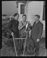 Dr. Earl A. Hershman and R. R. Granger present Joseph Van Dyke with his trophy, Artesia, 1935