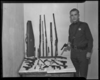 Deputy Sheriff James J. Claxton displays his private gun collection, Los Angeles, 1935