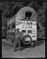 Chuckawalla Slim poses with his mobile trading post, Monrovia, 1935
