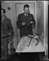Doug Howatt taking fingerprints at the murder scene of Dr. Charles DuBois, Los Angeles, 1935
