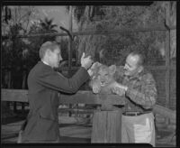 Robert D. Loken and Charles Gay at Gay's Lion Farm, El Monte, 1940
