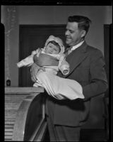 Superior Judge Blake holds newly adopted baby Shirley Anne, Los Angeles, 1935