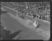 Official in a flower-covered automobile at the Tournament of Roses Parade, Pasadena, 1936