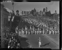 "Marching band and automobile with sign reading ""Director of Parade,"" at the Tournament of Roses Parade, Pasadena, 1936"