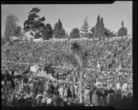 Grandstand spectators see the San Diego Exposition float at the Tournament of Roses Parade, Pasadena, 1936