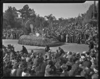 """100% American"" float at the Tournament of Roses Parade, Pasadena, 1936"