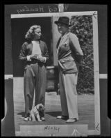 "Ted Healy and ""Bonnie"" Bonnell stand outside her home at 141 Mayberry Road, Santa Monica, 1935"